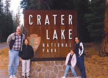 Crater Lake sign with family taken in 1995